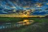 Sunburst over wetland islands (Kansas Poetry (Patrick)) Tags: wetlands nature sky sunset sunbeams color reflections islands patrickemerson patricklovesnancydearly