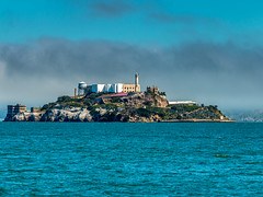 Alcatraz viewed from Fishermans Warf (RickyBats) Tags: wanderlust travel landscapes history abandoned alcatraz blue bluewater california clouds fog historic jail morning ocean prison sanfrancisco sky sun unitedstates us