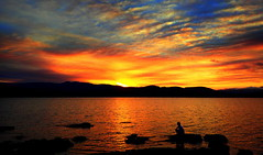 A Young Boy Dreams BIG (Lani Elliott) Tags: sky skies cloud clouds sunset scene scenic view serene bright fiery colour color colourful vibrant light child boy silhouette silhouettes water river australia tasmania scenictasmania northwestbay gorgeous wow beautiful
