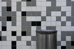 Trash can and tiles (Jan van der Wolf) Tags: map151162v vuilnisbak garbagecan trashcan tiles tegels grey monochrome monochroom wall muur station
