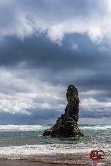 Oregon Monolith #2 (KnightedAirs) Tags: bandon beach oregon d5200 nikon nikkor 35mm digital afs ocean stone rock formation monolith sand sky clouds landscape nature coast coastal blue warm sun