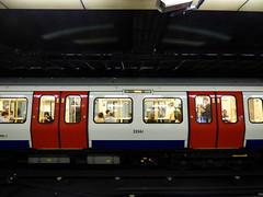Mind the Gap (Steve Taylor (Photography)) Tags: blue black white red people england london glow mindthegap tube train doors underground camera surveillance curve windows