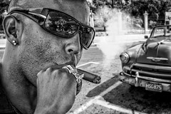 Name of The Game.. (u c c r o w) Tags: cuba cuban male sunglasses cigar smoke smoker smoking automobile oldtimer blackandwhite uccrow havana ring latino latin