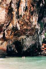People are at Phra Nang cave (Princess cave) on Railay island, Krabi, Thailand (donnchans) Tags: andaman asia cave krabi phranangcave pranang princesscave railay thai thailand bay beach beautiful cliff coast coastline editorial indochina island landscape nature ocean paradise people rock rocky sand scenery sea seascape shore stone summer swimming tourism tourist travel tropical vacation water white