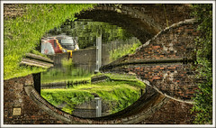 Twisted reality (david.hayes77) Tags: staffordshire milford canal 2017 virgin pendolino class390 staffordshireandworcestershirecanal bridge wcml westcoastmainline arty reflection transport waterway twistedreality illusion cameo