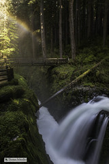 Sol Duc Falls and Rainbow from the Mist (Thomas Schoeller Photography) Tags: solducriver solducfalls spectrumoflight rainbow fogbow mist cascades enchantment footbridge waterfalls waterfall washington rainforest hoh refractedlight sunsbeams luminous luminouslight flume gorge rockygorge spectacularscenery 32aspectratio fineart fineartnature naturefineart schoellerfineart moss forestlandscapes forestscenes forested deepforest mysterious riversandstreams picturesofriversandlakes naturephotography nationalparks nationalparksoftheusa nationalforest olympicnationalpark intimatelandscape olympicpeninsula soaked soaking epiphytes multicoloredarc arc