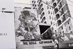 Keep Walking (jcbkk1956) Tags: bangkok ekkamai street sign advertising mono blackwhite film analog 35mm contax 167mt ilford pan100 carlzeiss 45mmf28 manualfocus buildings wall mural worldtrekker michelen johnnywalker