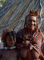 Himba tribe - a Himba village in Kaokoland, Namibia. (One more shot Rog) Tags: himba safrai kaokoland namibia namibiantribes tribe tribal tribes himbawoman himbawomen himbapeople villageochreafricaafrican peopleone more shot rogtraveltravel africa safari