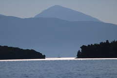 Ionian Islands and the Greek mainland (robin denton) Tags: lefkas lefkada greekislands greece skorpios ioniansea ionianislands yacht mountain contrejour morning blue seascape sea coast greek