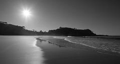Mine alone (OzzRod) Tags: pentax k1 smcpentaxa20mmf28 coast shoreline beach swash waves sun sunburst intothesun silhouette monochrome blackandwhite solitude barraggabay