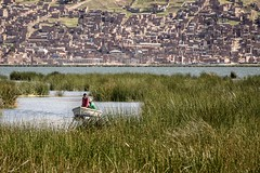 Lonely boat and the city of Puno in the background, Titicaca Lake. (dvdcrst) Tags: titicaca boat puno lake