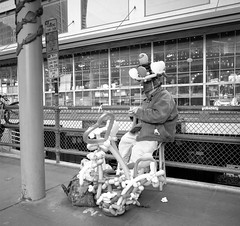 Ballon man Pike Place (1 of 1) (sailronin) Tags: streetphotography ballonman pikeplacemarket seattle man balloons sitting busker film analog blackandwhite bw fujineon acros carlzeiss rolleiflex planar80 rolleiplanar80 rolleiflex6008 120film hc110