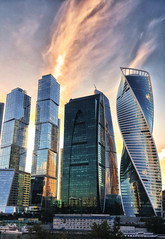 Moscow City sunset (NO PHOTOGRAPHER) Tags: hochhaus gebäude cityscape skyline detail blackandwhite monochrome building outdoor architecture iphoneography iphonephotography exterier urban blue skycraper iphone 6s panorama panoramatic москва россия архитектура строительство река мост