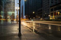 Rainy Morning at the Bus Stop (tquist24) Tags: chicago illinois michiganavenue nikon nikond5300 busstop city downtown geotagged lightstream lighttrails lights longexposure rain rainy reflection reflections street urban unitedstates morning