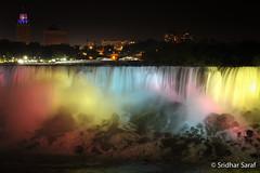 Niagara Falls at Night, New York (USA) (SridharSaraf) Tags: 2010 americanfalls canada illumination ny newyork newyorkphotography niagarafalls niagarafallsnightview niagarafallsatnight niagarariver ontario photography summer usa unitedstates unitedstatesofamerica untedstatesphotography