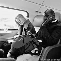 Book or Phone, that's the question... (Akbar Simonse) Tags: trein train people candid man woman book boek reading holland netherlands nederland smartphone telefoon passengers reizigers zwartwit bw blancoynegro bn monochrome vierkant square streetphotography streetshot straatfotografie straatfoto akbarsimonse