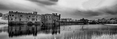 Castle on the lake (David Feuerhelm) Tags: nikkor building old castle history historical lake leedscastle kent blackandwhite bw contrast landscape reflections tower infared silverefex panorama photoshop nikon d90 ir