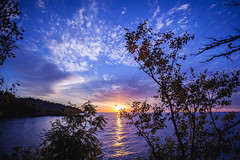 Sunrise on the North Shore (michaelraleigh) Tags: northshore sunrise f28l lakesuperior reflection 2035mm lake clouds morning sun silhouette beautiful sky secluded shadows serene outdoors park canoneos5dmarkii canon red minnesota