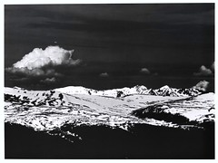 Ansel Adams, Rocky Mountain National Park, Never Summer Range, circa 1941, Colorado (lhboudreau) Tags: book books hardcover hardcovers hardcoverbook hardcoverbooks bookart artbook artwork artofphotography photographybook bookofphotography firstedition americanphotographers thenationalparks americanphotographersandthenationalparks robertcahn robertglennketchum vikingpress 1981 nationalparks nationalpark monochrome blackwhite blackandwhite mountain mountains snow rockymountains rockies rockymountainnationalpark anseladams mountainrange neversummerrange 1941 colorado cloud clouds fieldofsnow