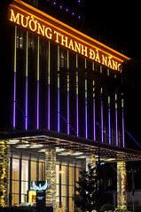 Golden touch (Roving I) Tags: portecochère hotels tourism travel nightlife signs gold pillars logos flagships design danang architecture muongthanh vertical vietnam lighting