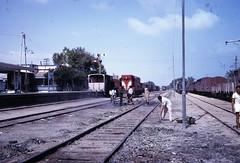 Egypt Railways - El Arish train station, 1967 - Egyptian State Railways diesel locomotive Nr. 3526 and captured rolling stock (color slide) (HISTORICAL RAILWAY IMAGES) Tags: israel egypt railways isr esr train diesel locomotive emd elarish sinai 1967 gm g8