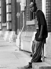 Sreet Corner Boy. (Neil. Moralee) Tags: neilmoralee usa2017neilmoralee black white mono man street corner face portrait candid monochrome neil moralee nikon d7200 mature mobile alabama usa confederate quiet bored alone