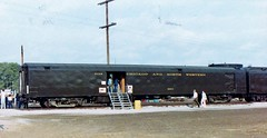 Chicago Northwestern [privately owned] baggage-display car at 8903 Council Bluffs Iowa in 1985 128 (Tangled Bank) Tags: old classic heritage fallen flag train railway railroad western north american cnw chicago northwestern privately owned baggagedisplay car 8903 council bluffs iowa 1985 128 passenger rolling stock