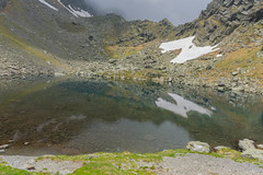 Glacial lake (BAV Photography) Tags: wild water explore exploring experience beautifulview romania travel trekking outdoor pointofview panorama adventure atmospheric atmosphericshot amazingview awesomeview awesomelight snow d7200 discovery fieldofview filter gorgeous hiking landscape lake clouds colours view glacial nikon nature nowords nationalgeographic naturewonders natural mountain mountains mirroring ngc