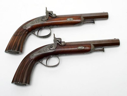 "French Dueling Pistols and Accessories ($5,320.00): Top of barrel marked ""Ad Jansen arquebusier du Roi Bruxelles."" Set displayed in fitted wooden case with custom made stand."
