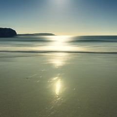 Trevone Bay, Cornwall (Bruus UK) Tags: cornwall beach trevone bay sun sunlight reflection brightness sand atlantic sea waves surf alone glistening sparkle sparkling seascape blur motion coast marine tide