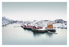 Shared territories 2 (Artery-Crea) Tags: norway snow winter lofoten boat yellow red houses réflexion water mountains fineartphotography longexposure juliencarcano