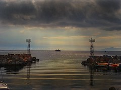 Cloudy and rainy day.. (panoskaralis) Tags: port boats fishingboats lightbeacon lighthouse sun sunlight sunrise bluesky sky cloud clouds rain sea seaside seagull seascape beach shore coast fishermen fishing outdoor landscape light aegean aegeansea