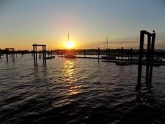 Sunset (KaDeWeGirl) Tags: newyorkcity bronx cityisland marina pilings sunset sailboat