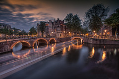 Amsterdam sunset (angheloflores) Tags: amsterdam canal houses keizersgracht city travel sunset clouds sky colors urban explore bridge lights netherlands longexposure wideangle 15mm