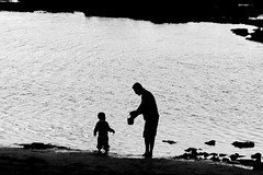 with a little help from my Dad (Wackelaugen) Tags: lascanteras father son beach water laspalmas grancanaria spain europe canaries canaryislands canaryisles canon eos photo photography wackelaugen black white bw blackwhite blackandwhite mono noiretblanc schwarz weis schwarzweis fathersday dad daddy summer