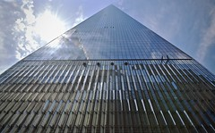 Freedom Tower (tim.perdue) Tags: nyc new york city vacation 2017 big apple metropolis lower manhattan world trade center wtc freedom tower 911 memorial september 11th downtown urban building skyscraper architecture lines pattern repetition geometry vanishing point minimalism sky clouds reflection glass sun sunlight lens flare