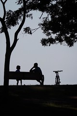 (janetbland) Tags: canoneos bench trees boys son father bicycle park black silhouettes