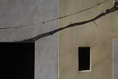 Es sind nur wir zwei und wer uns begleiten mag (raumoberbayern) Tags: urbanfragments robbbilder wall wand frankreich france building haus abstract minimal shadow schatten cable kabel