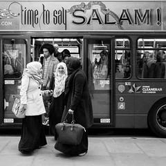 London 013 (Peter.Bartlett) Tags: bag noiretblanc women unitedkingdom people city doorway square standing lunaphoto man girl text candid urbanarte urban woman bus bw streetphotography sign blackandwhite monochrome peterbartlett london england gb