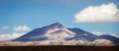 Peruvian Hills (kate willmer) Tags: mountain cloud light shadows landscape altiplano altitude colour rocks peru