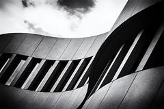 ArchiMinimal B&W (Lunor 61) Tags: abstract abstrakt minimal minimalismus minimalistisch minimalistic urban city building gebaeude facade fassade architecture architektur lines linien curves textures windows sky clouds schwarz weis black white bw sw ireneeberwein