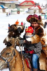 Hitchikers (carfull...home from Mongolia) Tags: mongolian mongolia eagle goldeneagle raptor hunter horse child candid ger winter bogd khan national park forest snow