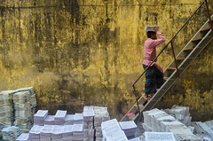 Working at press! (ashik mahmud 1847) Tags: bangladesh d5100 nikkor people man working paper pattern