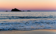 Sunset on the Coast with Island (Merrillie) Tags: sand landscape sunset nature australia mountains ocean newsouthwales sea southcoast sun batemansbay beach scenery seascape trees pink coastal island nsw waterscape clouds coast water snapperisland