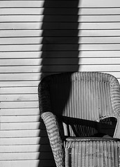 wicker chair :: front porch (dotintime) Tags: wicker woven reed chair casual comfortable rest sit still porch black white dark light shadow contrast wood wooden siding clapboard old dotintime meganlane