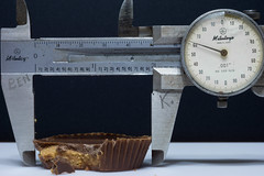 measuring calories (what's_the_frequency) Tags: reeses candy ilovereesesday chocolate peanutbutter caliper gauge measure measuring calories sony a65 sugar sweet sweets snack span needle dial