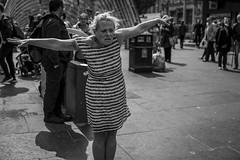 I Believe I Can Fly (Leanne Boulton) Tags: monochrome people urban street candid portrait portraiture streetphotography candidstreetphotography candidportrait streetportrait streetlife woman female face facial expression look emotion feeling mood dance dancing dancer performer motion movement pose action posture art music dress tone texture detail depth naturallight outdoor light shade shadow city scene human life living humanity society culture canon canon5d 5dmarkiii 50mm character ef2470mmf28liiusm black white blackwhite bw mono blackandwhite glasgow scotland uk