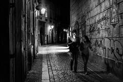 May 23, 2017.jpg (pavelkhurlapov) Tags: noir streetphotography cobblestone graffiti monochrome shadows light lamps walkway couple night
