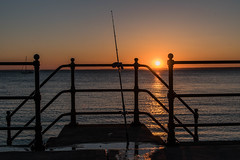 DSF_2080.jpg (alfiow) Tags: fishingrod railings sunset totland