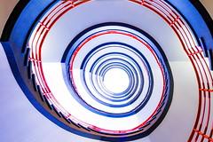 Red, blue and lots of white (Maerten Prins) Tags: germany duitsland deutschland hamburg stair stairs stairwell staircase spiral orange railing metal reflection upshot sprinkenhof curve curves circle